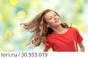 Купить «smiling teenage girl in red with long wavy hair», фото № 30933019, снято 17 февраля 2019 г. (c) Syda Productions / Фотобанк Лори