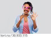 Купить «happy african american woman with big glasses», фото № 30933115, снято 2 марта 2019 г. (c) Syda Productions / Фотобанк Лори