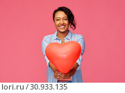 Купить «african american woman with heart-shaped balloon», фото № 30933135, снято 2 марта 2019 г. (c) Syda Productions / Фотобанк Лори