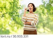 Купить «woman pointing finger up over natural background», фото № 30933331, снято 6 марта 2019 г. (c) Syda Productions / Фотобанк Лори