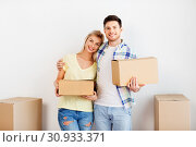 Купить «happy couple with boxes moving to new home», фото № 30933371, снято 25 февраля 2016 г. (c) Syda Productions / Фотобанк Лори