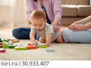 Купить «happy family with baby boy playing at home», фото № 30933407, снято 5 мая 2018 г. (c) Syda Productions / Фотобанк Лори