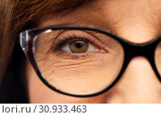 Купить «close up of face of senior woman in glasses», фото № 30933463, снято 8 февраля 2019 г. (c) Syda Productions / Фотобанк Лори