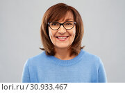 Купить «portrait of senior woman in glasses over grey», фото № 30933467, снято 8 февраля 2019 г. (c) Syda Productions / Фотобанк Лори