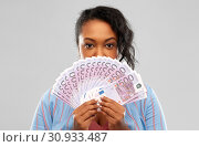Купить «excited african american woman with euro money», фото № 30933487, снято 2 марта 2019 г. (c) Syda Productions / Фотобанк Лори