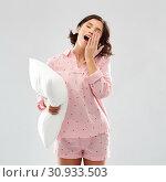 Купить «sleepy yawning young woman in pajama with pillow», фото № 30933503, снято 6 марта 2019 г. (c) Syda Productions / Фотобанк Лори