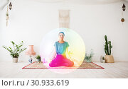 Купить «woman meditating in lotus pose at yoga studio», фото № 30933619, снято 21 июня 2018 г. (c) Syda Productions / Фотобанк Лори