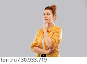 Купить «red haired teenage girl in checkered shirt», фото № 30933719, снято 28 февраля 2019 г. (c) Syda Productions / Фотобанк Лори