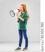 Купить «smiling red haired girl speaking to megaphone», фото № 30933783, снято 9 марта 2019 г. (c) Syda Productions / Фотобанк Лори