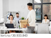 Купить «sad office workers looking at fired colleague», фото № 30933843, снято 23 марта 2019 г. (c) Syda Productions / Фотобанк Лори