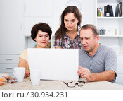 Купить «Senior couple with adult daughter», фото № 30934231, снято 28 мая 2020 г. (c) Яков Филимонов / Фотобанк Лори