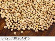 Купить «Dried chickpea groats», фото № 30934415, снято 14 июня 2019 г. (c) Яков Филимонов / Фотобанк Лори