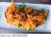 Купить «Toast with smoked salmon, avocado, greens, sesame», фото № 30934503, снято 19 июня 2019 г. (c) Яков Филимонов / Фотобанк Лори