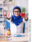 Купить «Female doctor in hijab working in the hospital», фото № 30935535, снято 20 февраля 2019 г. (c) Elnur / Фотобанк Лори
