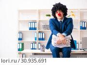 Купить «Young clown businessman working in the office», фото № 30935691, снято 14 декабря 2018 г. (c) Elnur / Фотобанк Лори