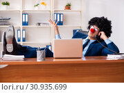 Купить «Young clown businessman working in the office», фото № 30935699, снято 14 декабря 2018 г. (c) Elnur / Фотобанк Лори