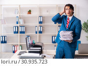 Купить «Young employee making copies at copying machine», фото № 30935723, снято 14 декабря 2018 г. (c) Elnur / Фотобанк Лори