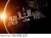Купить «International Space Station over the planet Earth. Elements of this image furnished by NASA.», фото № 30938227, снято 27 мая 2020 г. (c) easy Fotostock / Фотобанк Лори