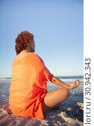 Купить «Woman doing yoga on beach in the sunshine», фото № 30942343, снято 15 марта 2019 г. (c) Wavebreak Media / Фотобанк Лори