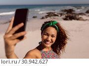 Купить «Beautiful woman taking selfie with mobile phone on beach in the sunshine», фото № 30942627, снято 15 марта 2019 г. (c) Wavebreak Media / Фотобанк Лори