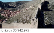 Купить «Defensive Northern wall of Albarracin on background of cityscape with Cathedral tower, Aragon, Spain», видеоролик № 30942975, снято 25 декабря 2018 г. (c) Яков Филимонов / Фотобанк Лори