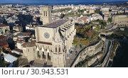 Купить «Aerial view of Manresa town with Basilica de Santa Maria, Catalonia, Spain», видеоролик № 30943531, снято 24 декабря 2018 г. (c) Яков Филимонов / Фотобанк Лори