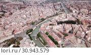 Купить «Aerial view of Murcia cityscape with a segura river and apartment buildings, Spain», видеоролик № 30943579, снято 17 апреля 2019 г. (c) Яков Филимонов / Фотобанк Лори