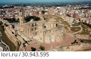 Купить «Panoramic view from drone of Catalan city of Lleida with medieval Cathedral of St. Mary of La Seu Vella», видеоролик № 30943595, снято 25 июля 2018 г. (c) Яков Филимонов / Фотобанк Лори