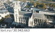 Купить «View from drone of impressive Roman Catholic Cathedral of Tours in morning, France», видеоролик № 30943663, снято 25 октября 2018 г. (c) Яков Филимонов / Фотобанк Лори