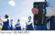 Купить «Women in national Russian costumes are dancing. And the man plays the accordion», видеоролик № 30943851, снято 23 июля 2019 г. (c) Константин Шишкин / Фотобанк Лори