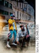 Купить «Black rappers in caps, city street on background», фото № 30948931, снято 5 апреля 2019 г. (c) Tryapitsyn Sergiy / Фотобанк Лори
