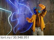 Black rapper in underpass neon light on background. Стоковое фото, фотограф Tryapitsyn Sergiy / Фотобанк Лори