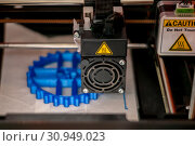 3D printer printhead while printing detail close-up. Стоковое фото, фотограф Евгений Харитонов / Фотобанк Лори