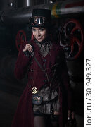 Купить «Portrait of a young beautiful steampunk woman», фото № 30949327, снято 10 июня 2019 г. (c) Алексей Кузнецов / Фотобанк Лори