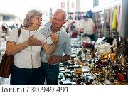 Купить «Loving mature couple buys alarm clock on flea market», фото № 30949491, снято 11 мая 2019 г. (c) Яков Филимонов / Фотобанк Лори