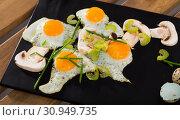 Купить «Dish of cooked scrambled quail eggs and champignons at plate», фото № 30949735, снято 26 января 2020 г. (c) Яков Филимонов / Фотобанк Лори
