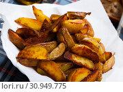 Купить «Dish with fried potato on checkered tablecloth», фото № 30949775, снято 20 ноября 2019 г. (c) Яков Филимонов / Фотобанк Лори