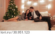Married couple are laughing and drinking wine at new year/s night in a hotel slow motion. Стоковое видео, видеограф Denis Mishchenko / Фотобанк Лори