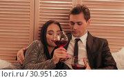 Купить «Sweet caucasian couple cheers for the new year and drink wine in a hotel celebrating their anniversary slow motion», видеоролик № 30951263, снято 16 июля 2020 г. (c) Denis Mishchenko / Фотобанк Лори