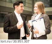 Купить «Portrait of couple who are standing with folder and coffee», фото № 30951307, снято 20 августа 2017 г. (c) Яков Филимонов / Фотобанк Лори