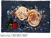Купить «Sweet cinnabon rolls with powdered sugar served with berries at plate», фото № 30951567, снято 25 июня 2019 г. (c) Яков Филимонов / Фотобанк Лори