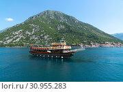 Купить «Perast, Montenegro - June 10. 2019. Beautiful excursion boat in a Boka-Kotorska bay», фото № 30955283, снято 10 июня 2019 г. (c) Володина Ольга / Фотобанк Лори