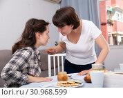 Купить «Emotional woman quarrelling with female friend at table with cookies», фото № 30968599, снято 19 июня 2019 г. (c) Яков Филимонов / Фотобанк Лори