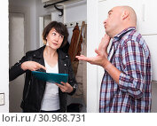 Купить «Adult man answers questions of the interviewer at home», фото № 30968731, снято 27 мая 2019 г. (c) Яков Филимонов / Фотобанк Лори