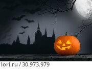 Купить «Halloween card with pumpkin, gothic castle, trees, flying bats silhouette and moon on background», фото № 30973979, снято 10 октября 2017 г. (c) easy Fotostock / Фотобанк Лори