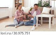 Купить «happy couple drinking red wine at home», видеоролик № 30975751, снято 10 июня 2019 г. (c) Syda Productions / Фотобанк Лори