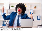 Купить «Young clown businessman working in the office», фото № 30978867, снято 14 декабря 2018 г. (c) Elnur / Фотобанк Лори