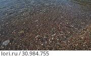Купить «Fragment of Mediterranean Sea coast with a pebble beach», видеоролик № 30984755, снято 11 июня 2019 г. (c) Володина Ольга / Фотобанк Лори