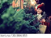 Happy girl staying at market Christmas trees. Стоковое фото, фотограф Яков Филимонов / Фотобанк Лори