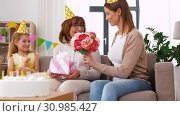 Купить «granddaughter greeting grandmother on birthday», видеоролик № 30985427, снято 14 июня 2019 г. (c) Syda Productions / Фотобанк Лори